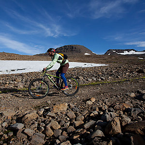 Mountain biking by snow in Westfjords Iceland