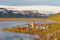 Beautiful camp in Leirufjordur. Drangajokull glacier in the background.
